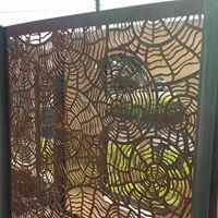 Nautilus privacy screens rear view iron bark metal design for Nautilus garden designs